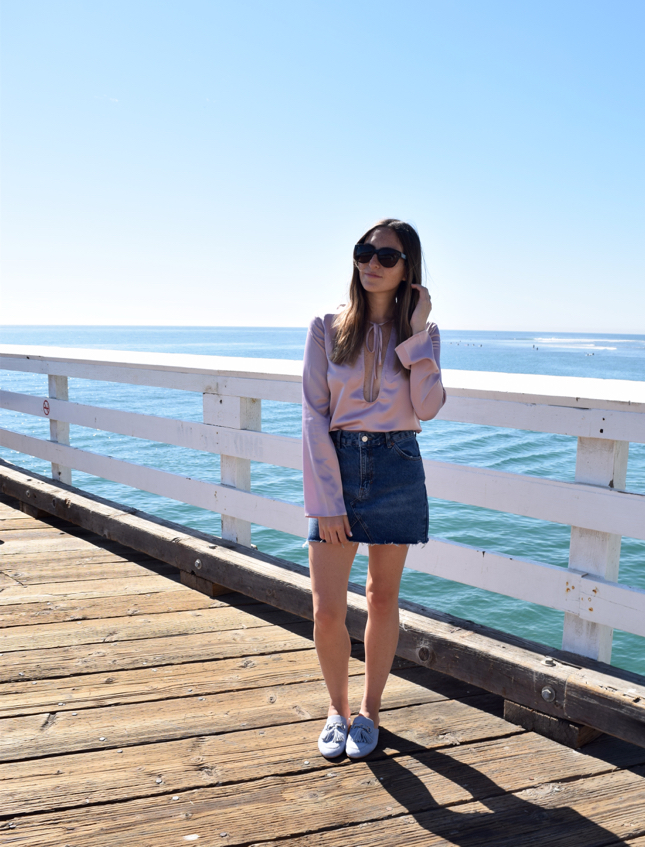 90s trends in 2016 chicago fashion blogger wears denim skirt loafers and silk top